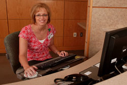 Receptionist Brenda Rew greets patients and their families.